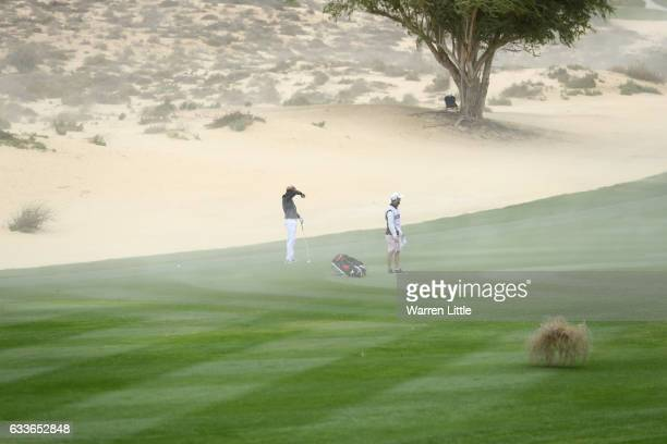 Nathan Kimsey of England reacts to the sand on the 8th hole during the second round of the Omega Dubai Desert Classic at Emirates Golf Club on...