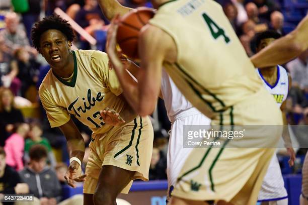Nathan Knight passes to teammate Omar Prewitt of the William Mary Tribe during the second half against the Delaware Fightin Blue Hens at the Bob...
