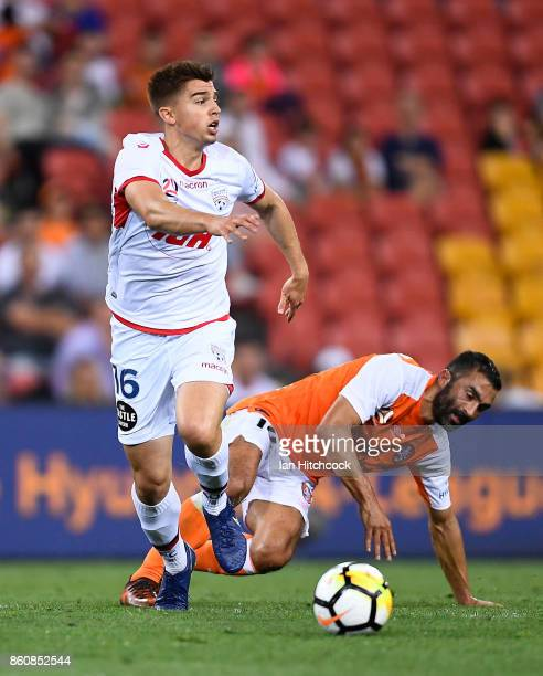 Nathan Konstandopoulos of Adelaide United looks to pass the ball during the round two ALeague match between the Brisbane Roar and Adelaide United at...