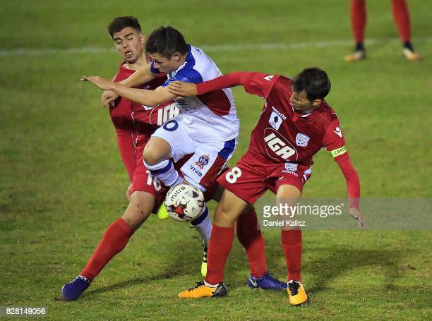 Nathan Konstandopoulos of United Wayne Brown of United and Isaas Sanchez of United compete for the ball during the round of 32 FFA Cup match between...
