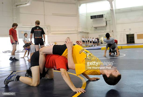 Nathan Kraisser a rising junior at Centennial High School in yellow works out with Cole Gallagher a rising senior at Spalding while training at the...