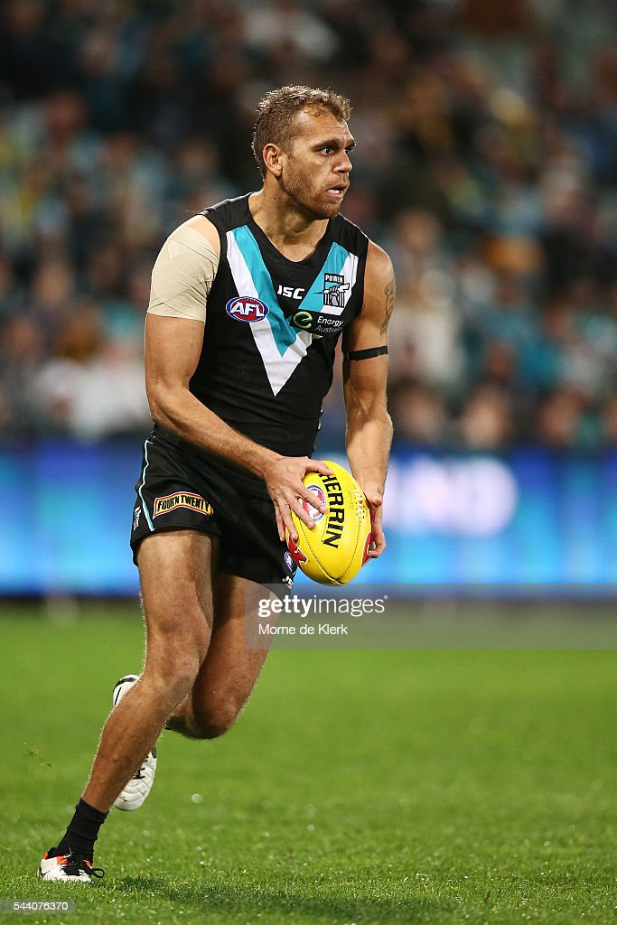 Nathan Krakouer of the Power runs with the ball during the round 15 AFL match between the Port Adelaide Power and the Richmond Tigers at Adelaide Oval on July 1, 2016 in Adelaide, Australia.
