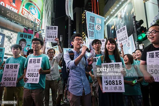 Nathan Law speaks at a rally with Jousha Wong and supporters in Causeway bay following Nathan Law's win in the Legislative Council election in Hong...