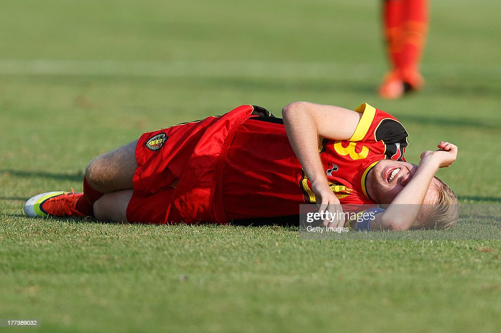 Nathan Leyder of Belgium lies injured on the field during the U17 Toto-Cup match between Germany and Belgium on August 21, 2013 in Gleisdorf, Austria.
