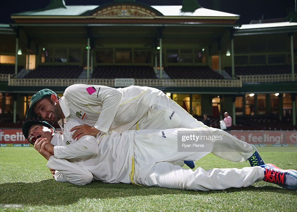 Nathan Lyon and Michael Clarke of Australia pose with the urn after day three of the Fifth Ashes Test match between Australia and England at Sydney Cricket Ground on January 5, 2014 in Sydney, Australia.