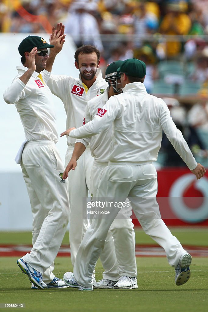 Nathan Lyon and Rob Quiney of Australia celebrate with their team mates after combining to take the wicket of Jacques Rudolph of South Africa during day three of the Second Test Match between Australia and South Africa at Adelaide Oval on November 24, 2012 in Adelaide, Australia.