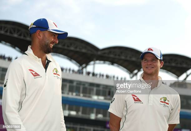 Nathan Lyon and Steve Smith of Australia talk after Australia defeated Bangladesh on day four of the Second Test match between Bangladesh and...