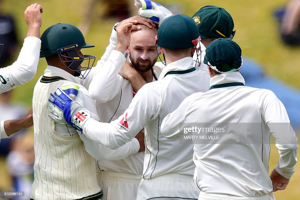 Nathan Lyon (C of Australia celebrates New Zealand's BJ Watling being bowled with team mates during day four of the first cricket Test match between New Zealand and Australia at the Basin Reserve in Wellington on February 15, 2016. / AFP / Marty Melville