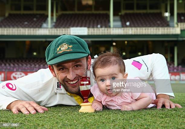 Nathan Lyon of Australia and daughter Harper Lyon pose with the urn after day three of the Fifth Ashes Test match between Australia and England at...