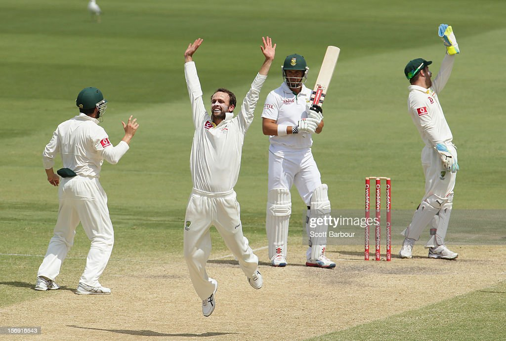 Nathan Lyon of Australia appeals for LBW against <a gi-track='captionPersonalityLinkClicked' href=/galleries/search?phrase=Jacques+Rudolph&family=editorial&specificpeople=208249 ng-click='$event.stopPropagation()'>Jacques Rudolph</a> of South Africa which was referred to the third umpire and given not out during day four of the Second Test Match between Australia and South Africa at Adelaide Oval on November 25, 2012 in Adelaide, Australia.