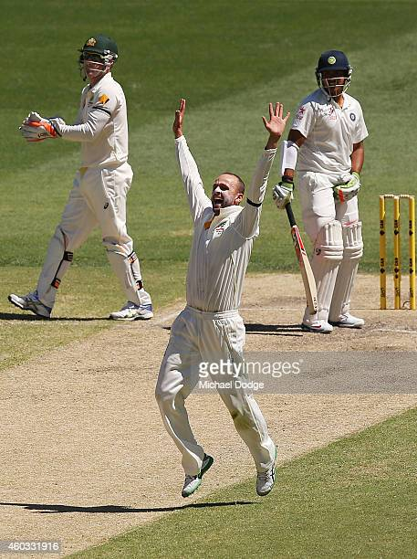 Nathan Lyon of Australia appeals for the wicket of Karn Sharma of India during day four of the First Test match between Australia and India at...