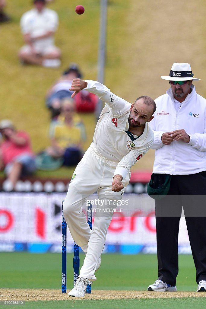 Nathan Lyon of Australia bowls during day four of the first cricket Test match between New Zealand and Australia at the Basin Reserve in Wellington on February 15, 2016. / AFP / Marty Melville