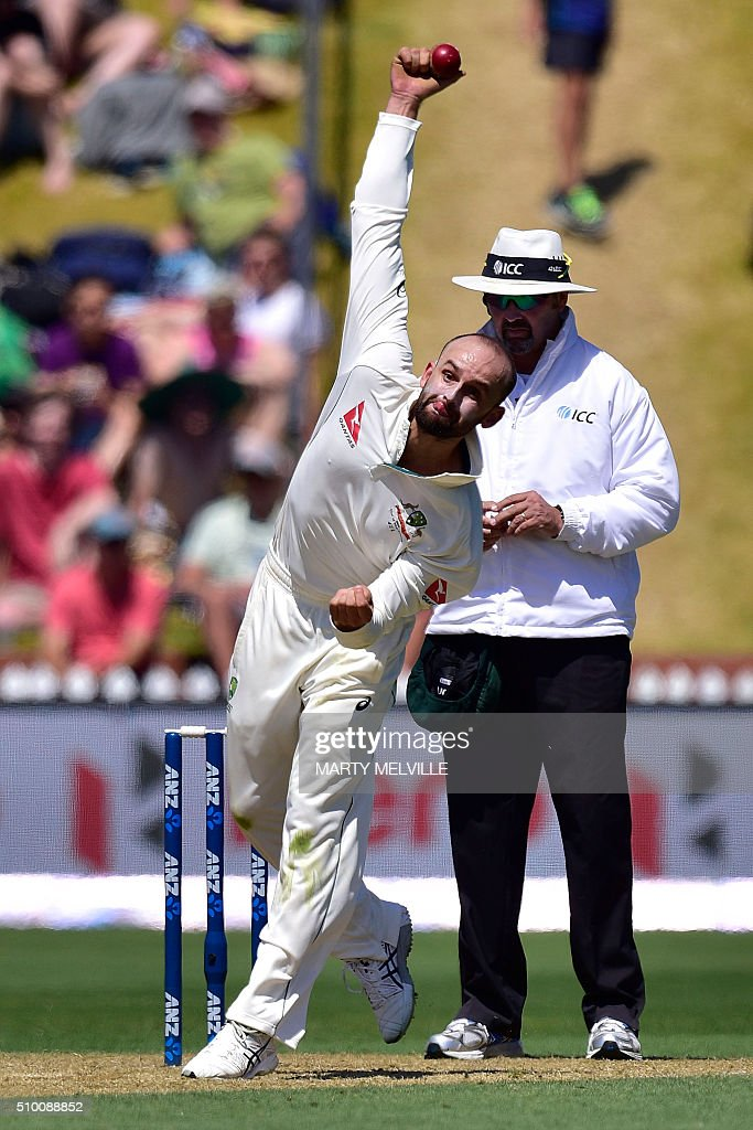Nathan Lyon of Australia bowls during day three of the first cricket Test match between New Zealand and Australia at the Basin Reserve in Wellington on February 14, 2016. AFP PHOTO / MARTY MELVILLE / AFP / Marty Melville