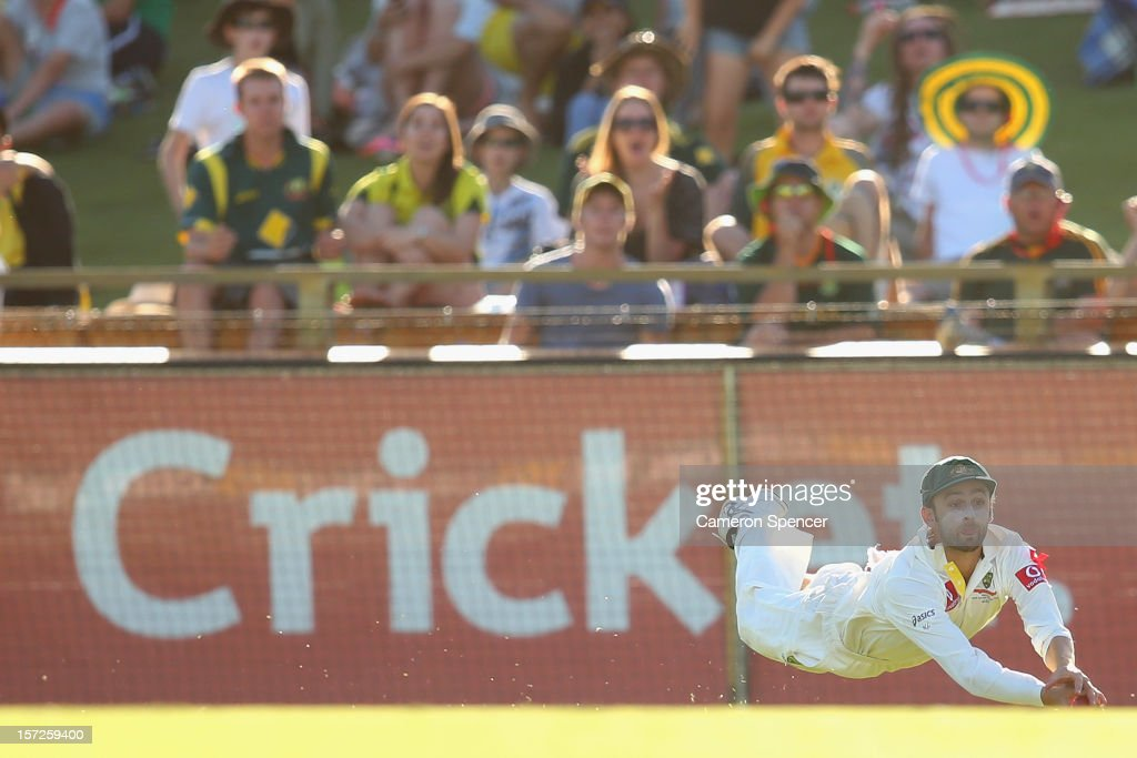 Nathan Lyon of Australia catches out South African captain Graeme Smith off a delivery by team mate Mitchell Starc during day two of the Third Test Match between Australia and South Africa at the WACA on December 1, 2012 in Perth, Australia.