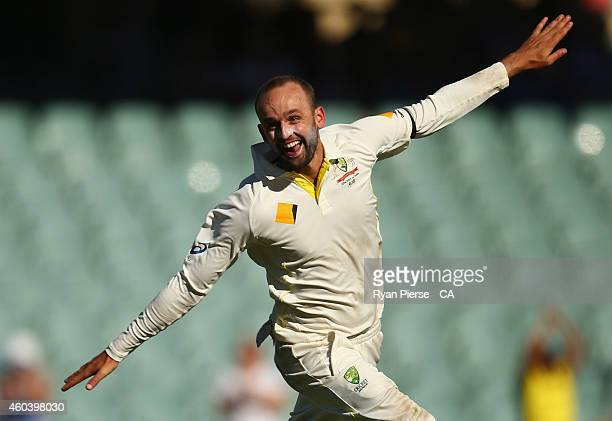 Nathan Lyon of Australia celebrates after taking the final wicket of Ishant Sharma of India to claim victory during day five of the First Test match...