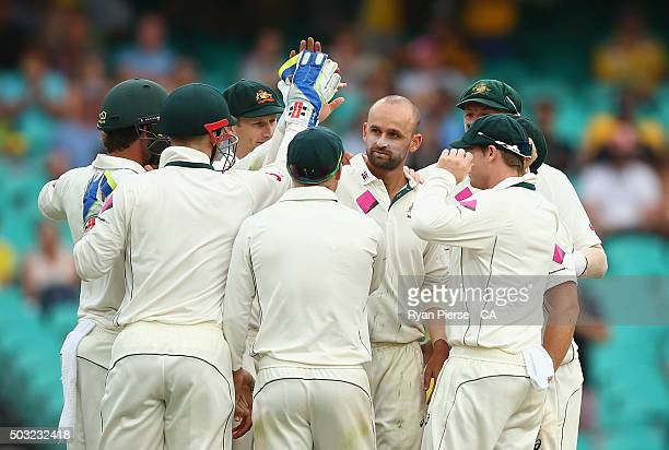 Nathan Lyon of Australia celebrates after taking the wicket of Kraigg Brathwaite of West Indies during day one of the third Test match between...