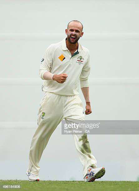 Nathan Lyon of Australia celebrates after taking the wicket of Martin Guptill of New Zealand during day four of the First Test match between...