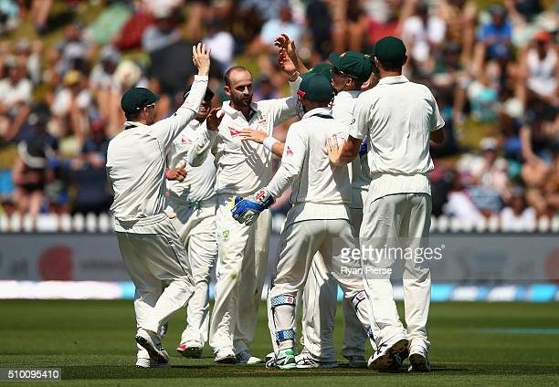 Nathan Lyon of Australia celebrates after taking the wicket of Martin Guptill of New Zealand during day three of the Test match between New Zealand...