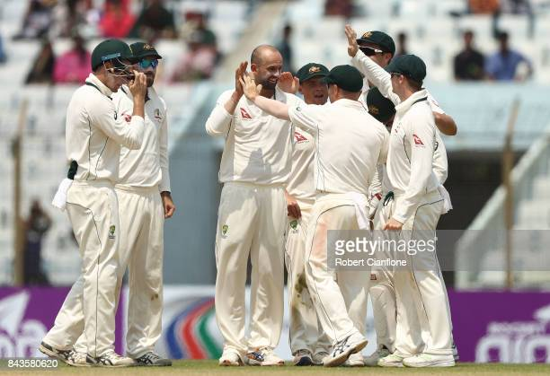Nathan Lyon of Australia celebrates after taking the wicket of Sabbir Rahman Roman of Bangladesh during day four of the Second Test match between...