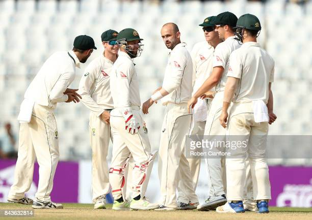 Nathan Lyon of Australia celebrates after taking the wicket of Taijul Islam of Bangladesh during day four of the Second Test match between Bangladesh...