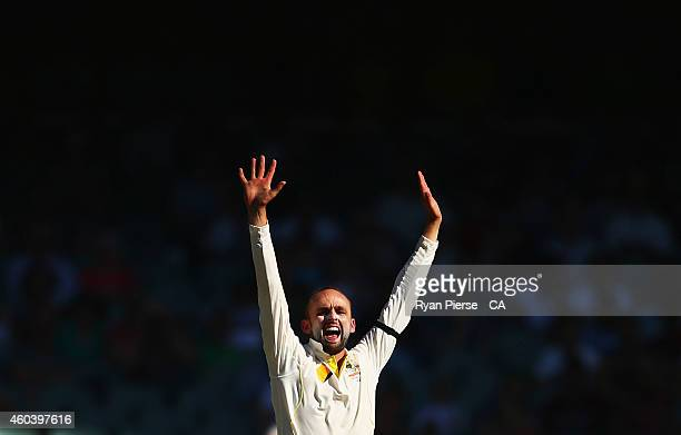 Nathan Lyon of Australia celebrates after taking the wicket of Virat Kohli of India during day five of the First Test match between Australia and...