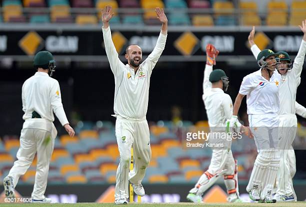 Nathan Lyon of Australia celebrates after taking the wicket of Younis Khan of Pakistan during day four of the First Test match between Australia and...