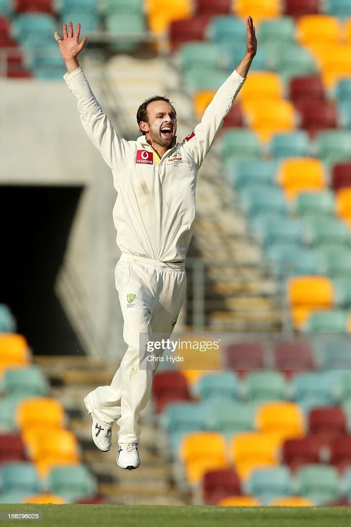 Nathan Lyon of Australia celebrates dismissing Jacques Rudolph of South Africa during day five of the First Test match between Australia and South Africa at The Gabba on November 13, 2012 in Brisbane, Australia.