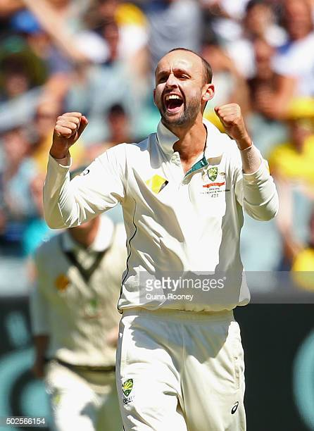 Nathan Lyon of Australia celebrates getting the wicket of Kraigg Brathwaite of the West Indies during day two of the Second Test match between...