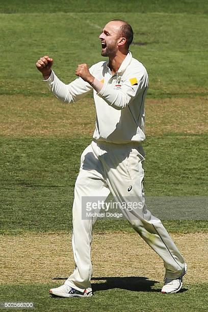 Nathan Lyon of Australia celebrates his wicket of Kraigg Brathwaite of the West Indies during day two of the Second Test match between Australia and...