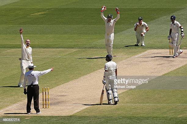 Nathan Lyon of Australia celebrates his wicket of Wriddhiman Saha of India caught out by Shane Watson during day four of the First Test match between...