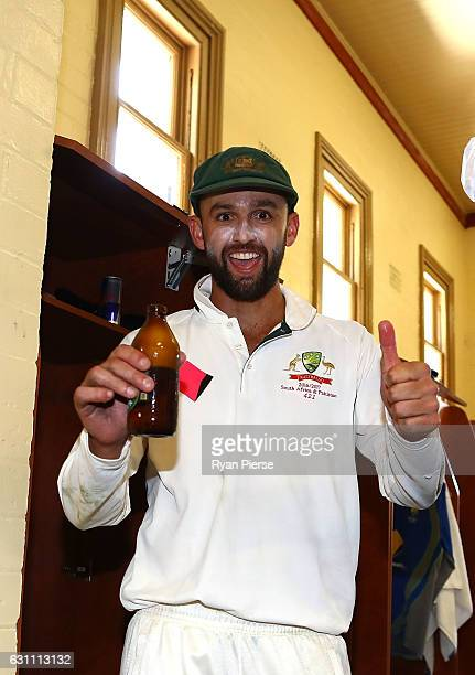 Nathan Lyon of Australia celebrates in the change rooms after day five of the Third Test match between Australia and Pakistan at Sydney Cricket...