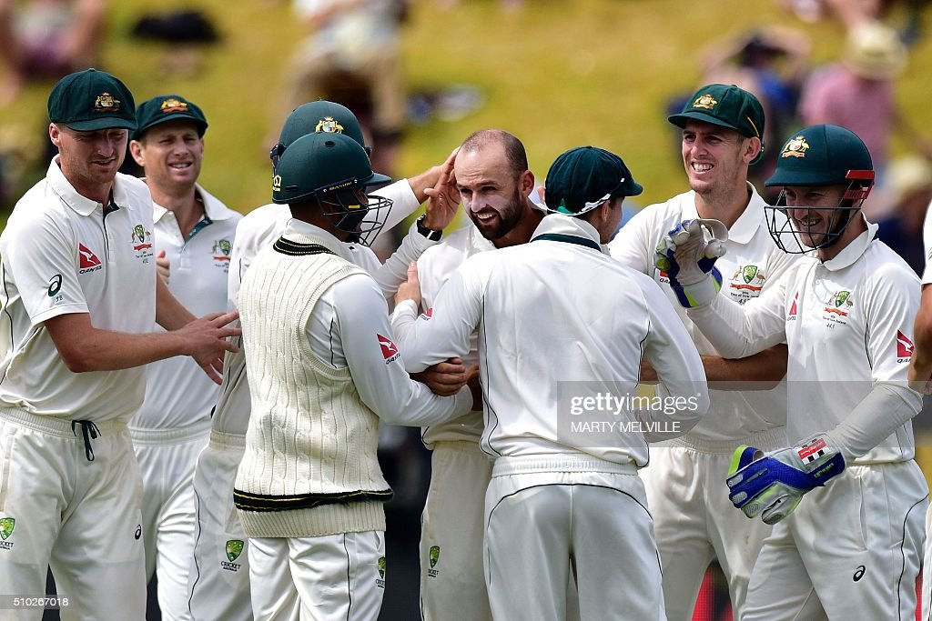 Nathan Lyon (C) of Australia celebrates New Zealand's BJ Watling being bowled with team mates during day four of the first cricket Test match between New Zealand and Australia at the Basin Reserve in Wellington on February 15, 2016. / AFP / Marty Melville