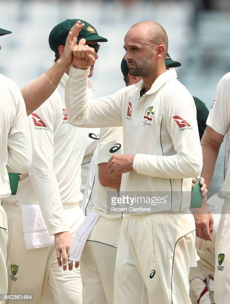 Nathan Lyon of Australia celebrates taking the wicket of Imrul Kayes of Bangladesh of Bangladesh during day one of the Second Test match between...