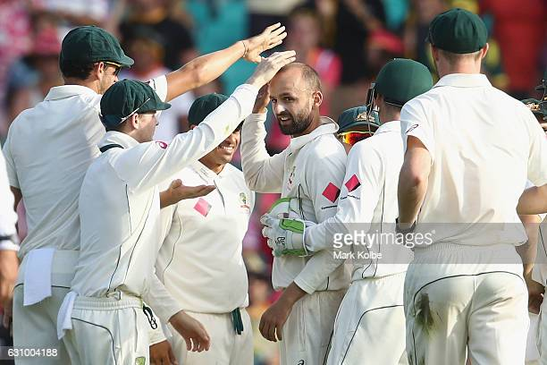 Nathan Lyon of Australia celebrates taking the wicket of Mohammad Amir of Pakistan during day three of the Third Test match between Australia and...