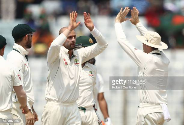 Nathan Lyon of Australia celebrates taking the wicket of Mominul Haque of Bangladesh of Bangladesh during day one of the Second Test match between...
