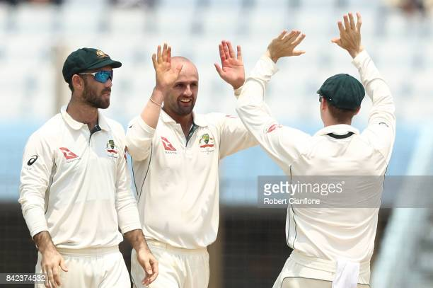 Nathan Lyon of Australia celebrates taking the wicket of Soumya Sarker of Bangladesh of Bangladesh during day one of the Second Test match between...