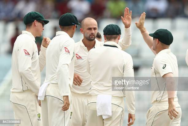 Nathan Lyon of Australia celebrates taking the wicket of Tamim Iqbal Khan of Bangladesh during day one of the Second Test match between Bangladesh...