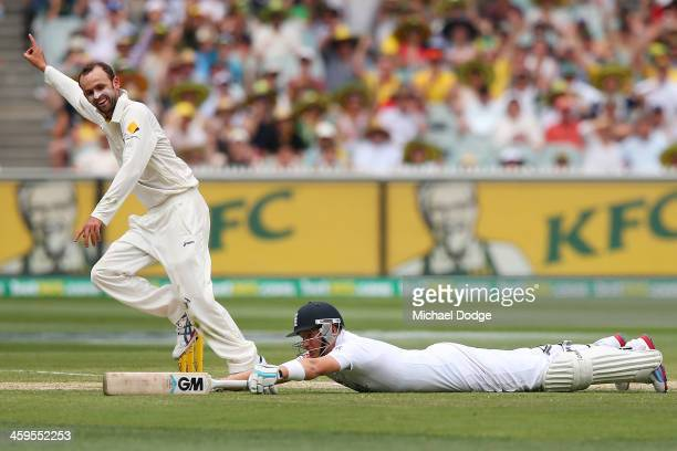 Nathan Lyon of Australia celebrates the run out of Joe Root of England during day three of the Fourth Ashes Test Match between Australia and England...