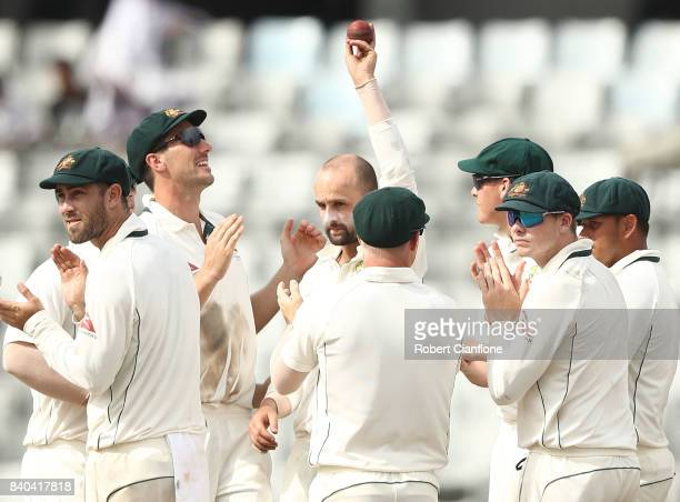 Nathan Lyon of Australia celebrates the wicket of Shafiul Islam of Bangladesh and five wickets for the innings during day three of the First Test...