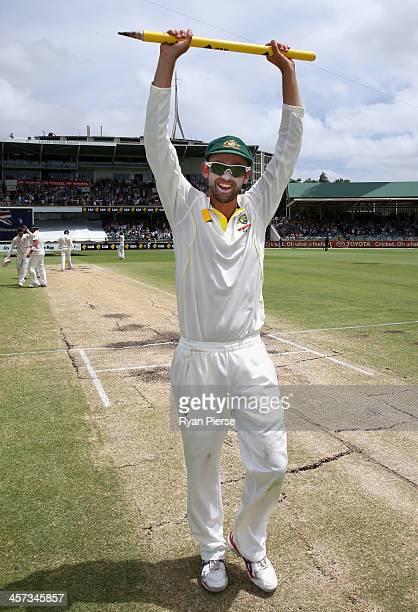 Nathan Lyon of Australia celebrates victory during day five of the Third Ashes Test Match between Australia and England at WACA on December 17 2013...