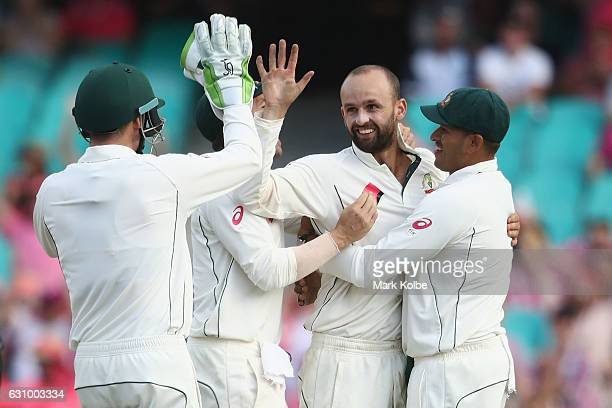 Nathan Lyon of Australia celebrates with his team mates after taking the wicket of Wahab Riaz of Pakistan during day three of the Third Test match...