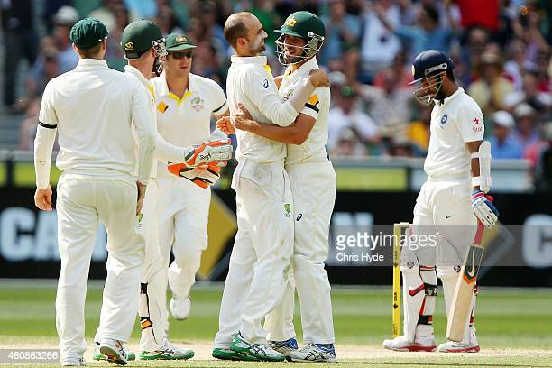 Nathan Lyon of Australia celebrates with team mates after dismissing Ajinkya Rahane of India during day three of the Third Test match between...