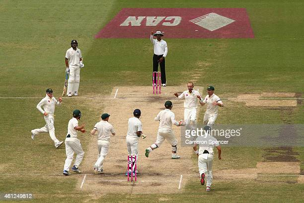 Nathan Lyon of Australia celebrates with team mates after dismissing Lokesh Rahul of India during day five of the Fourth Test match between Australia...