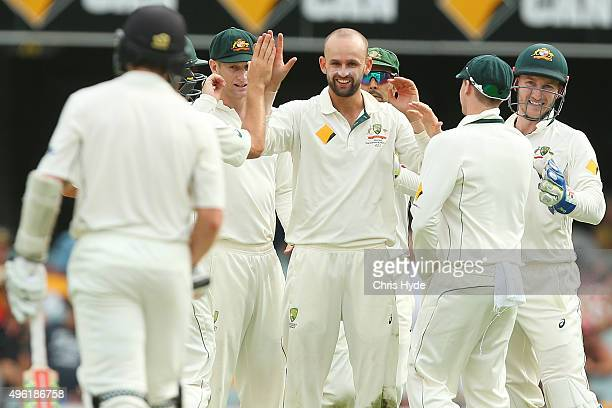Nathan Lyon of Australia celebrates with team mates after dismissing Kane Williamson of New Zealand during day four of the First Test match between...