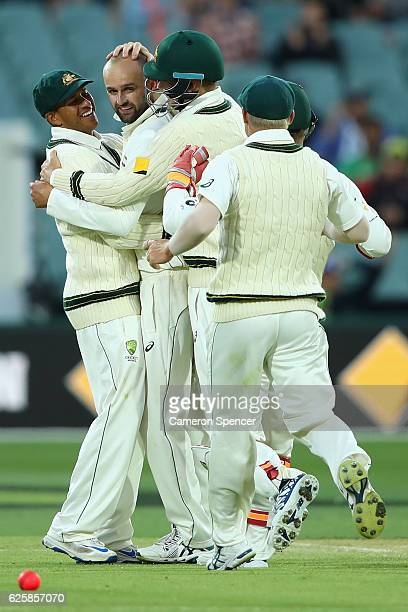Nathan Lyon of Australia celebrates with team mates after dismissing JeanPaul Duminy of South Africa during day three of the Third Test match between...