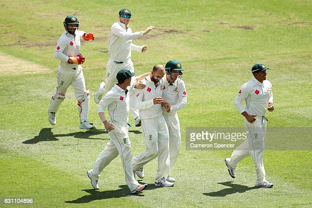 Nathan Lyon of Australia celebrates with team mates after dismissing Younis Khan of Pakistan during day five of the Third Test match between...