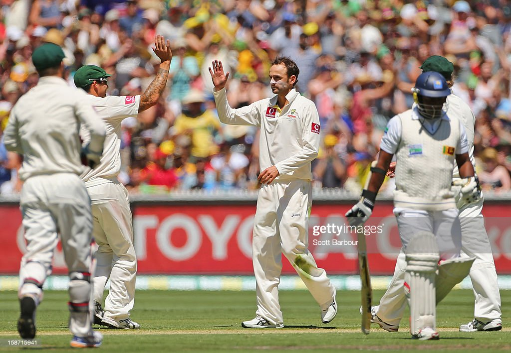 Nathan Lyon of Australia is congratulated by his team mates after dismissing Rangana Herath of Sri Lanka during day one of the Second Test match between Australia and Sri Lanka at Melbourne Cricket Ground on December 26, 2012 in Melbourne, Australia.