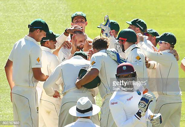 Nathan Lyon of Australia is congratulated by his teammates after taking the wicket of Carlos Brathwaite of the West Indies during day four of the...