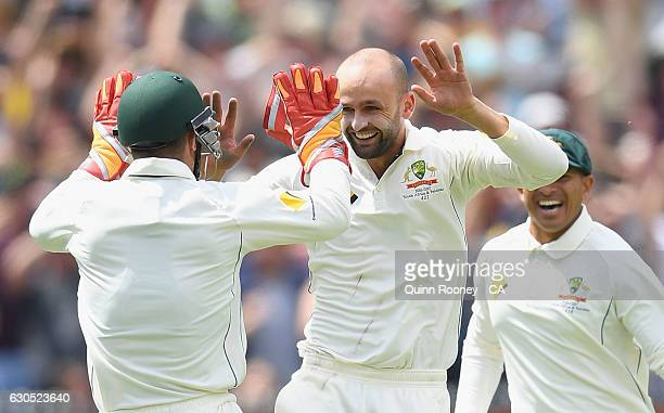 Nathan Lyon of Australia is congratulated by Matthew Wade after getting the wicket of Sami Aslam of Pakistan during day one of the Second Test match...