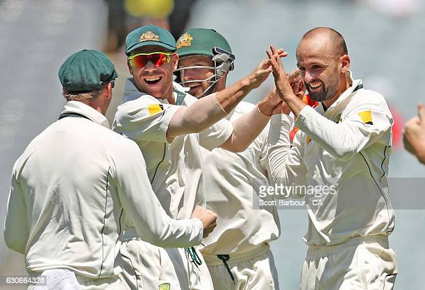 Nathan Lyon of Australia is congratulated by Steven Smith David Warner and Matthew Wade after dismissing MisbahulHaq of Pakistan during day five of...
